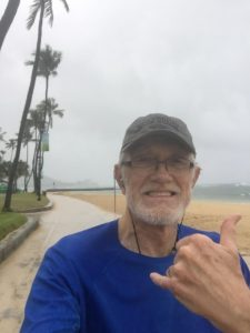 Running on the beach in the rain in Hawaii